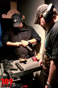 Mr Pheer and Ernie load the UMP45's magazines